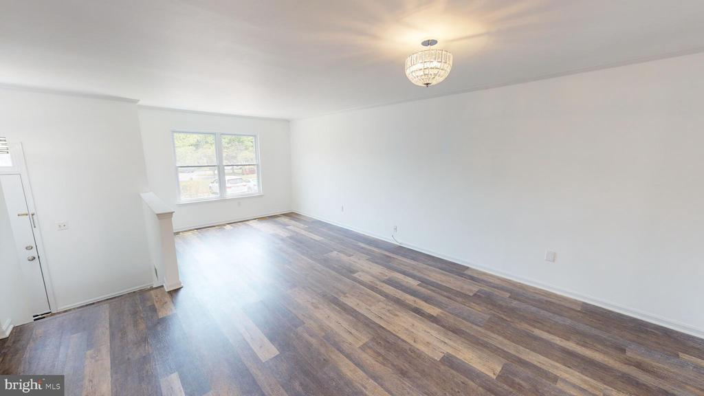 LR/DR with new Luxury Vinyl Plank flooring  (LVP) - 13616 WILDFLOWER LN, CLIFTON