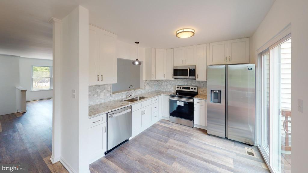 Kitchen has pantry and SGD to large deck - 13616 WILDFLOWER LN, CLIFTON