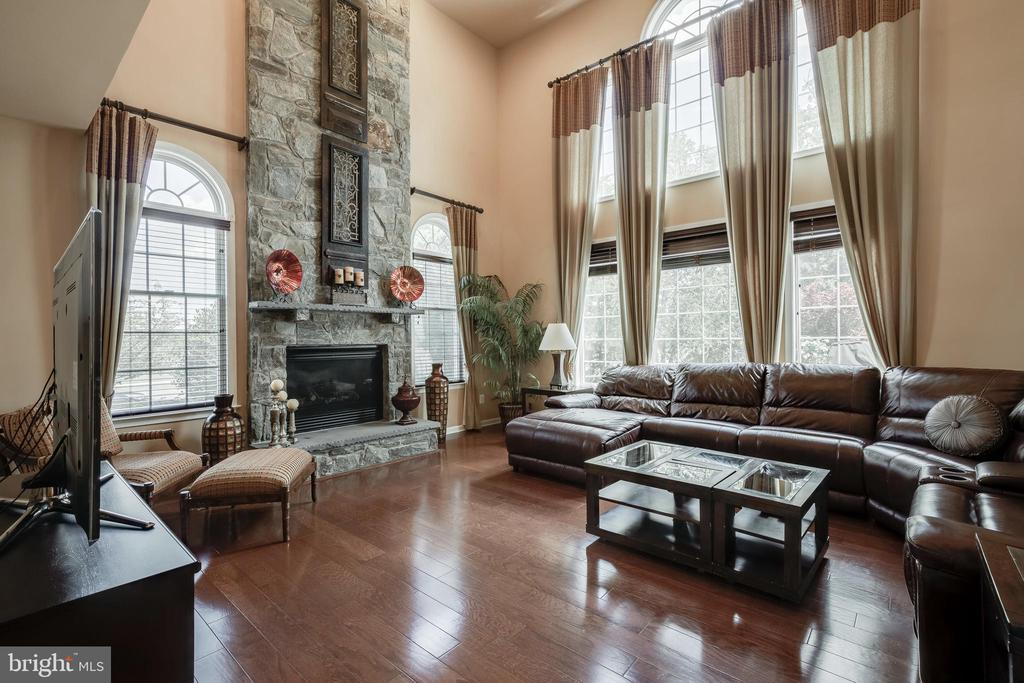 Two Story Family Room with a Gas Fireplace - 42355 EQUALITY ST, CHANTILLY