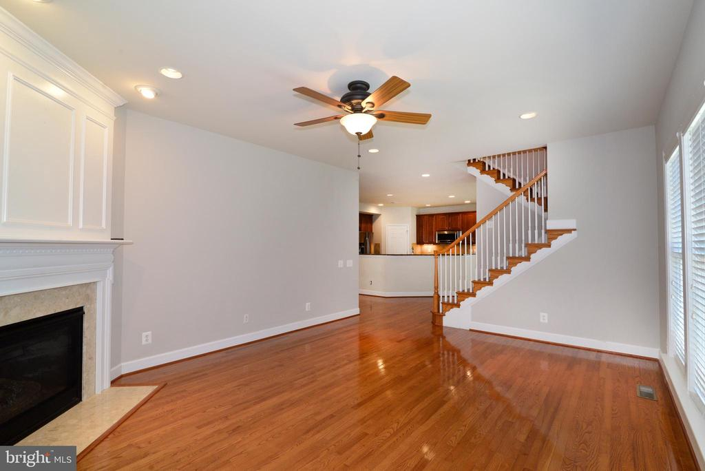 The family room features a gas fireplace - 42814 RAVENGLASS DR, ASHBURN
