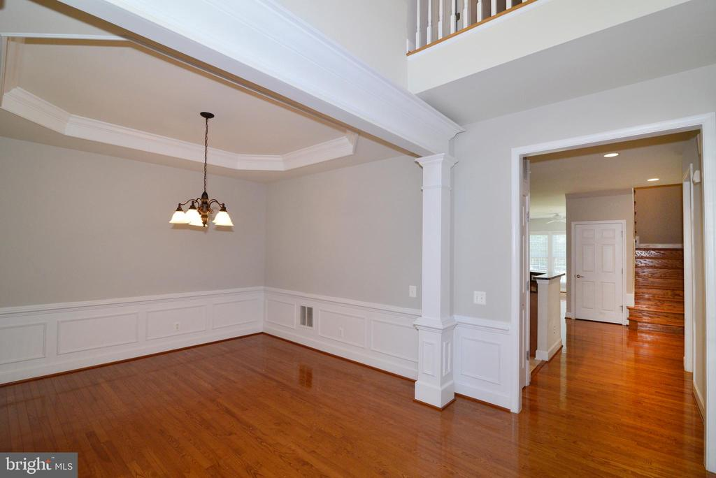 The entry features a double foyer and wainscoating - 42814 RAVENGLASS DR, ASHBURN