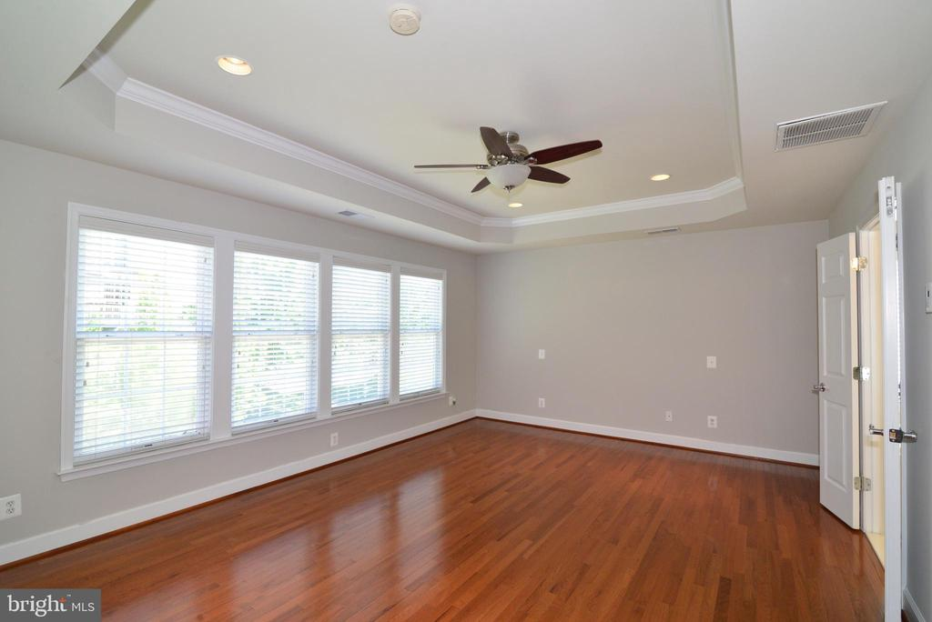 Enjoy the wonderful wall of windows in your master - 42814 RAVENGLASS DR, ASHBURN