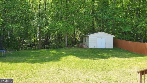 Backyard with Storage shed - 3107 VOYAGE DR, STAFFORD