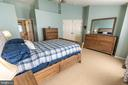 Master Bedroom features cathedral ceilings - 144 PEBBLE BEACH DR, CHARLES TOWN