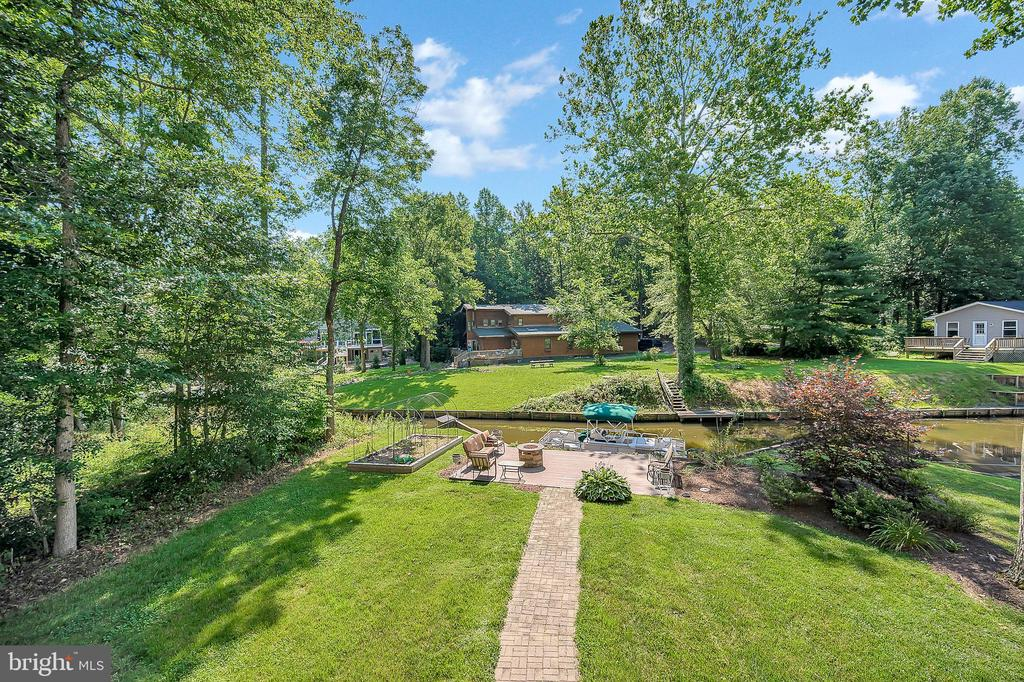 Well maintained and flat back yard. - 106 CONFEDERATE CIR, LOCUST GROVE