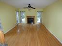 Family room w/ gas fireplace - breakfast area view - 43114 LLEWELLYN CT, LEESBURG