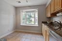 Kitchen with tiled flooring - 4023 CHESTERWOOD DR, SILVER SPRING