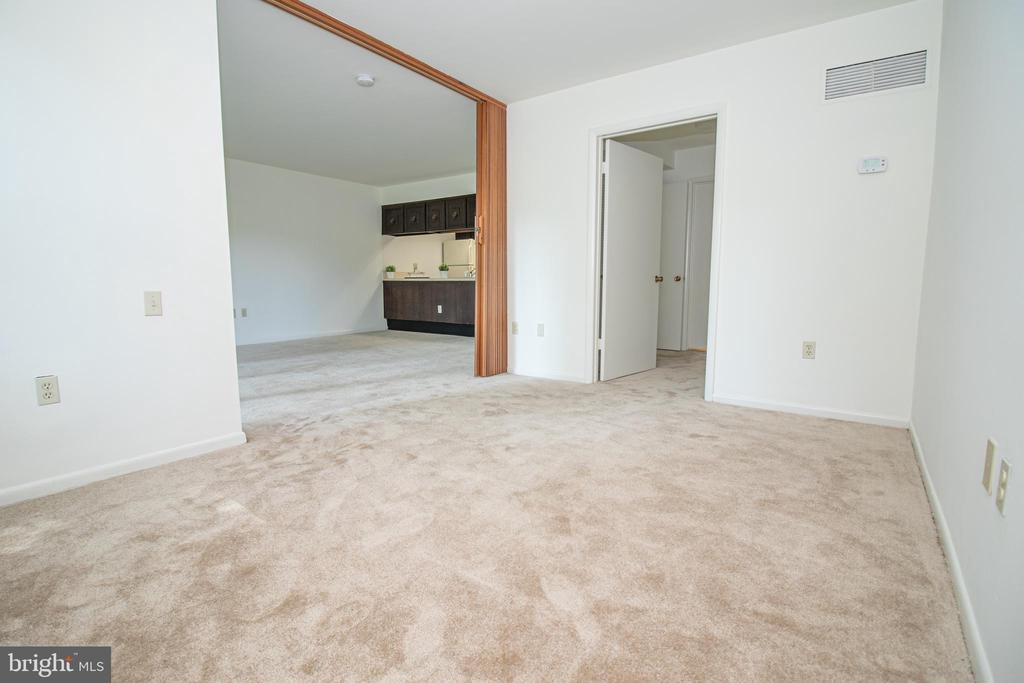 Bedroom looking into Living room - 3618 GLENEAGLES DR #7-1G, SILVER SPRING
