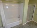 Master bath view of tub and show stall - 43114 LLEWELLYN CT, LEESBURG