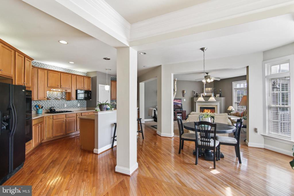 View from dining room to kitchen and family room - 19072 CRIMSON CLOVER TER, LEESBURG