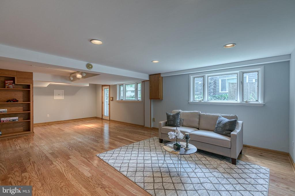 Spacious lower level family room with fireplace! - 3408 GREENTREE DR, FALLS CHURCH