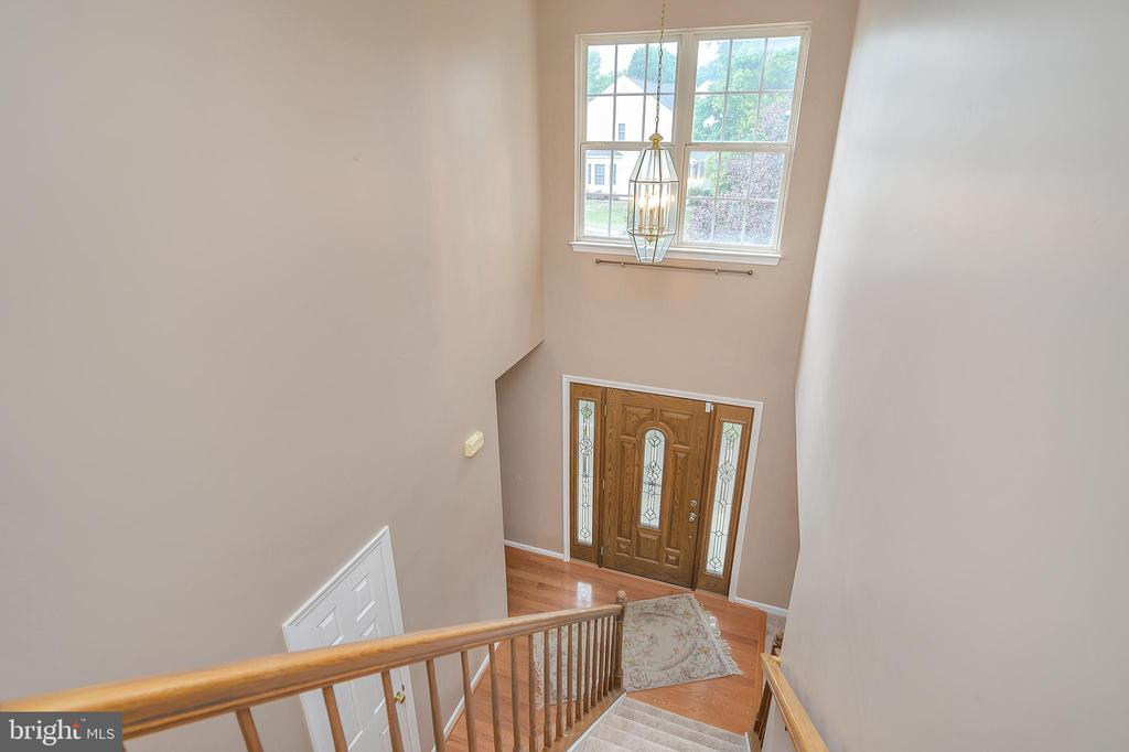 Two level entry foyer/view from upper level - 6 BRANTFORD DR, STAFFORD