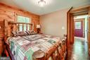 Main level bedroom with log furniture! - 13533 CATOCTIN HOLLOW RD, THURMONT