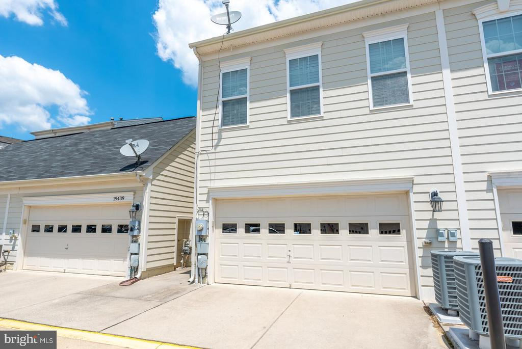 2 car garage with room for storage. - 19441 COPPERMINE SQ, LEESBURG