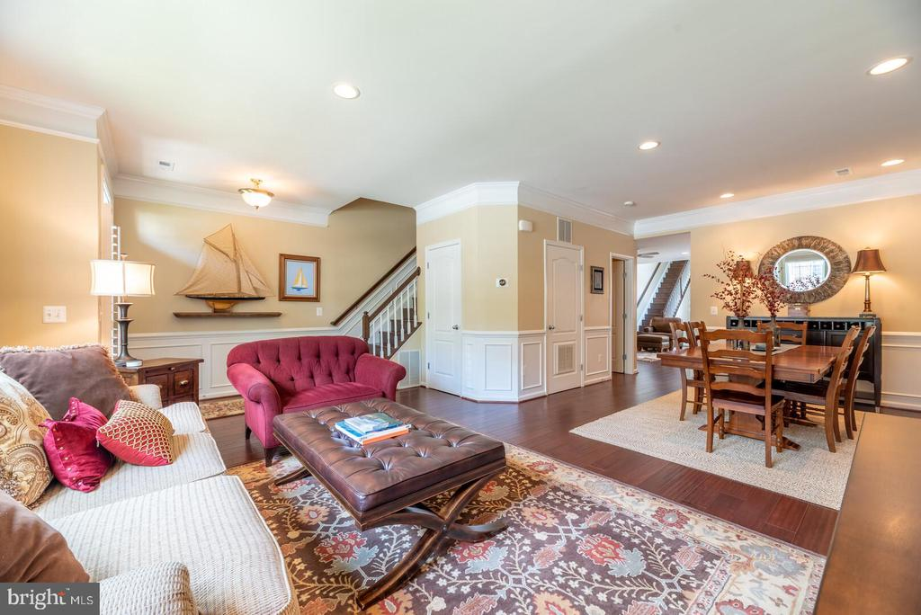 Open floor plan with living and dining rooms. - 19441 COPPERMINE SQ, LEESBURG