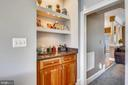 Family room niche with cabinetry and shelving - 9704 WOODFIELD CT, NEW MARKET