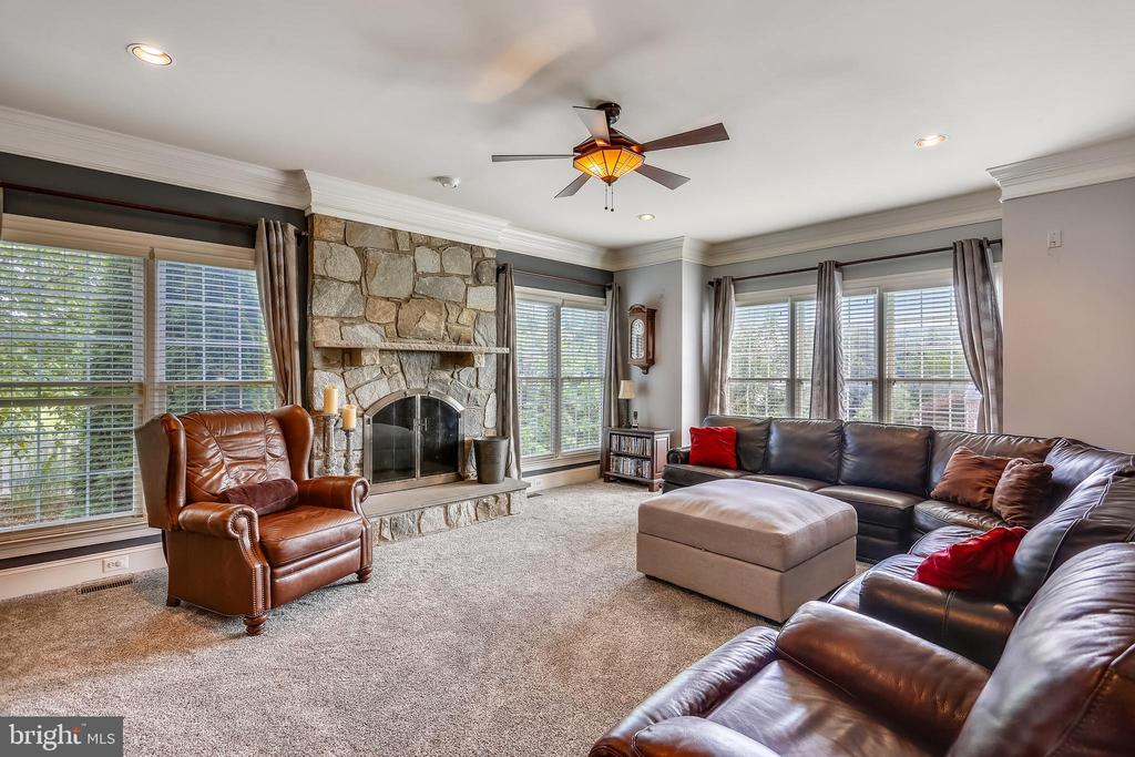 Family room has fieldstone gas fireplace - 9704 WOODFIELD CT, NEW MARKET