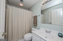 Ensuite Bath in Bedroom 2 with White Vanity - 26124 TALAMORE DR, CHANTILLY
