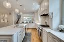 Marble counters and backsplash - 6221 ARKENDALE RD, ALEXANDRIA