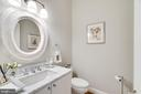 Main level half bath with marble vanity - 6221 ARKENDALE RD, ALEXANDRIA