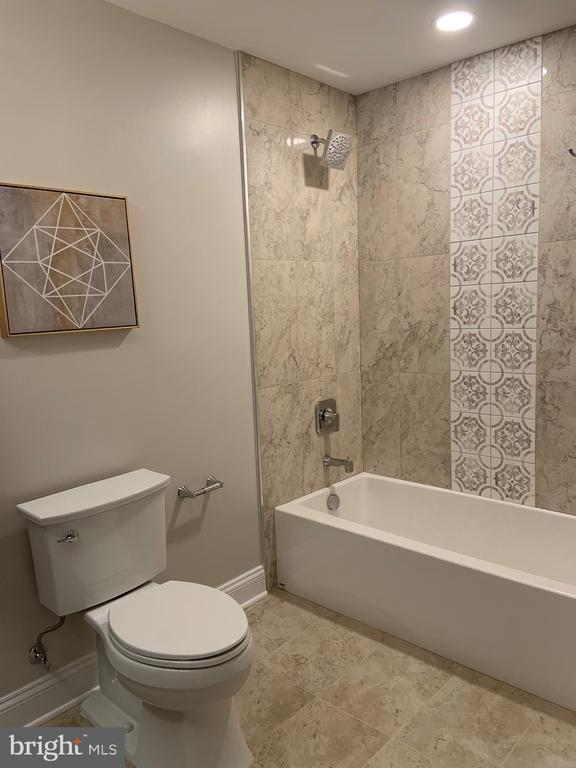 Full bathroom in basement (partial view) - 1523 GINGERWOOD CT, VIENNA