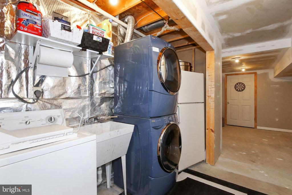 Laundry room leading to two extra storage areas - 6059 DOUGLAS AVE, NEW MARKET