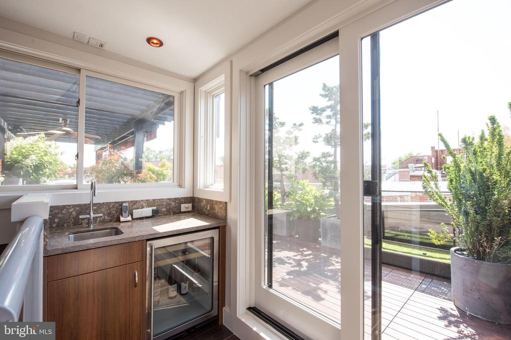 Penthouse with bar sink and beverage refrigerator - 1744 WILLARD ST NW, WASHINGTON