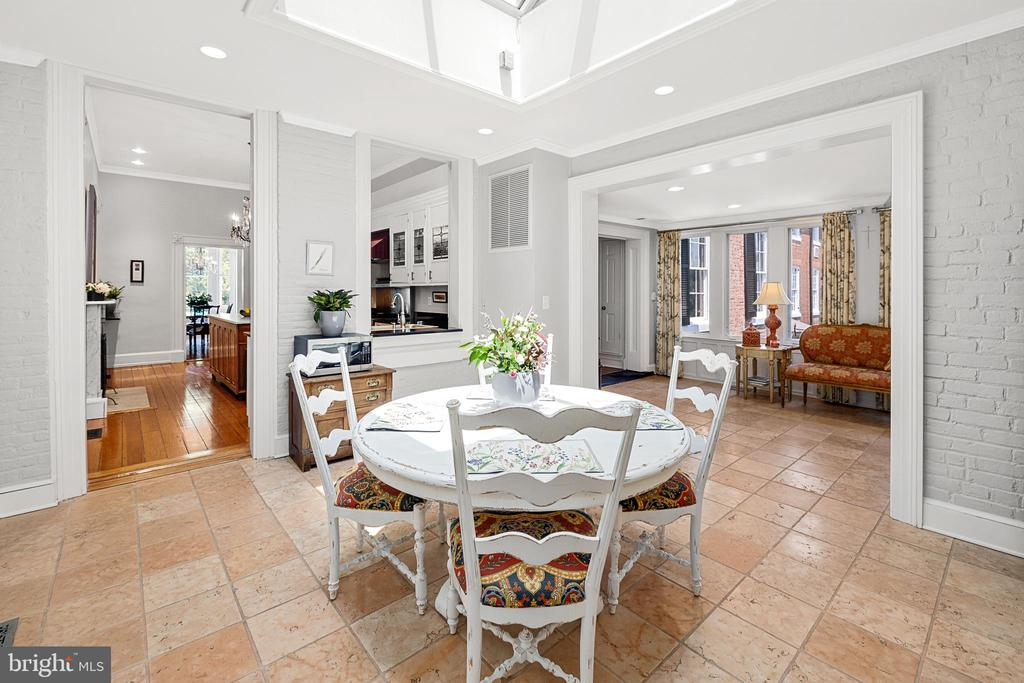 Kitchen leads to bright and open breakfast area. - 406 HANOVER ST, FREDERICKSBURG