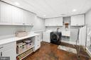 Laundry with storage and brick floors - 406 HANOVER ST, FREDERICKSBURG