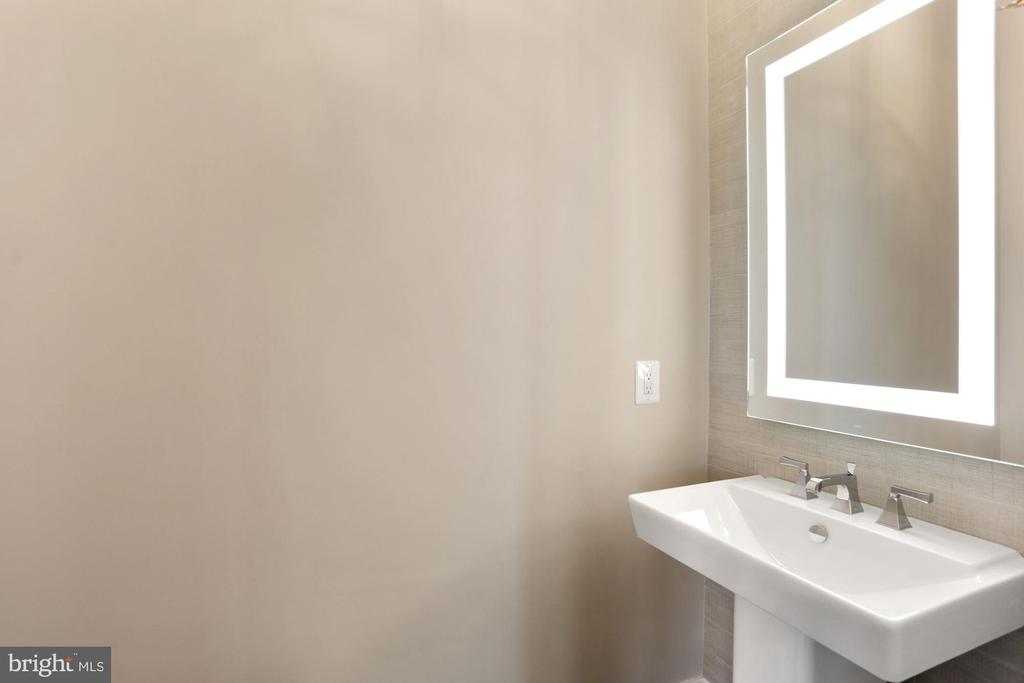 One of TWO powder rooms on the main level! - 105 MASHIE CT SE, VIENNA