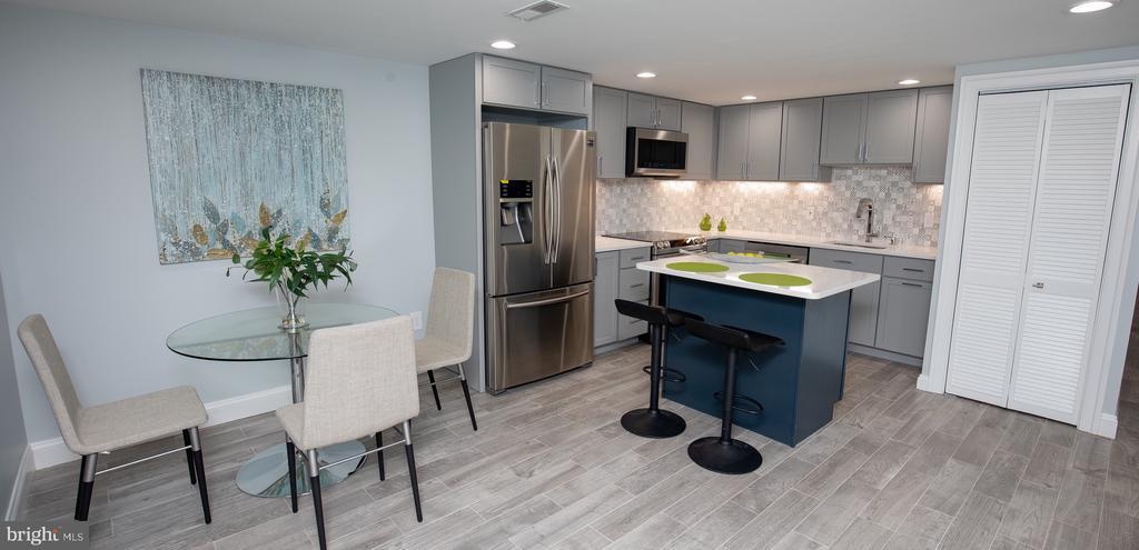 Lower level kitchen/dining area,quartz countertops - 50 BRYANT ST NW, WASHINGTON