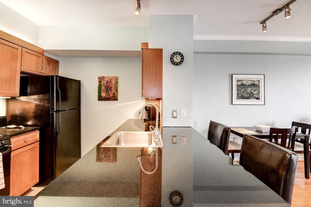 Combined Kitchen/Breakfast Bar Area - 616 E ST NW #1201, WASHINGTON