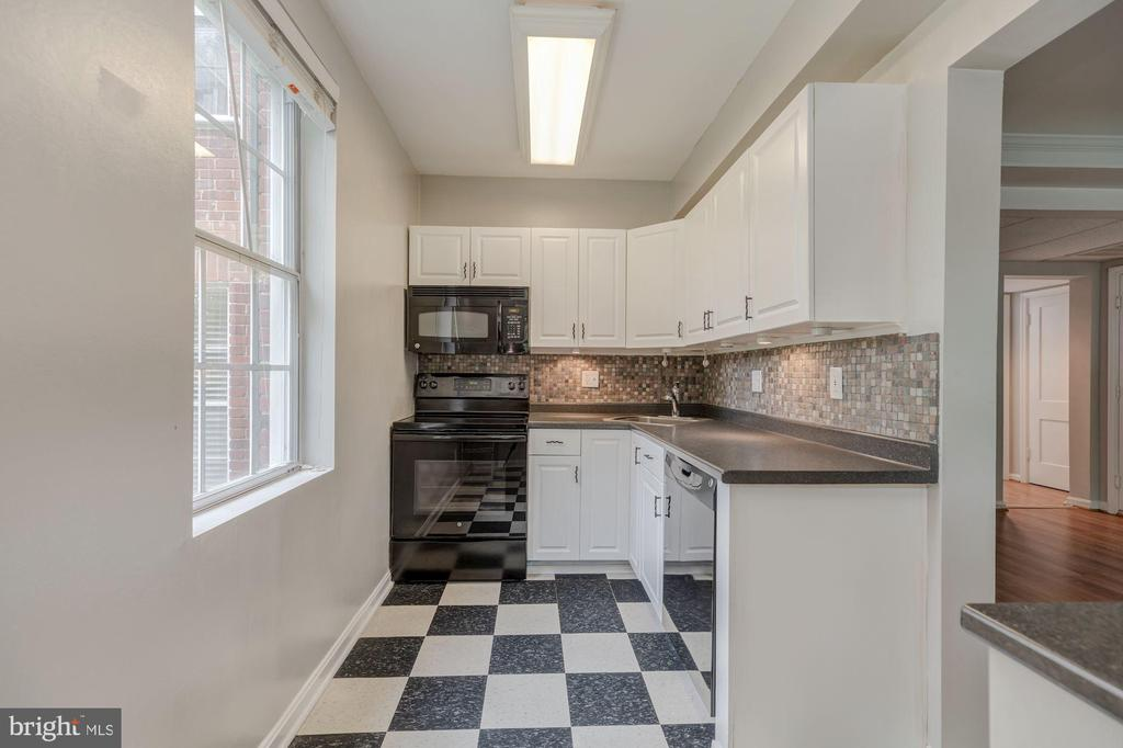 Kitchen with white cabinetry - 1913 N RHODES ST #17, ARLINGTON