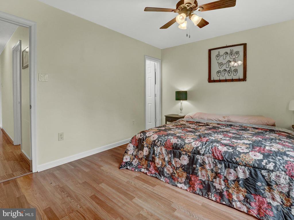 Master bedroom with en-suite half bath - 318 E D ST, BRUNSWICK