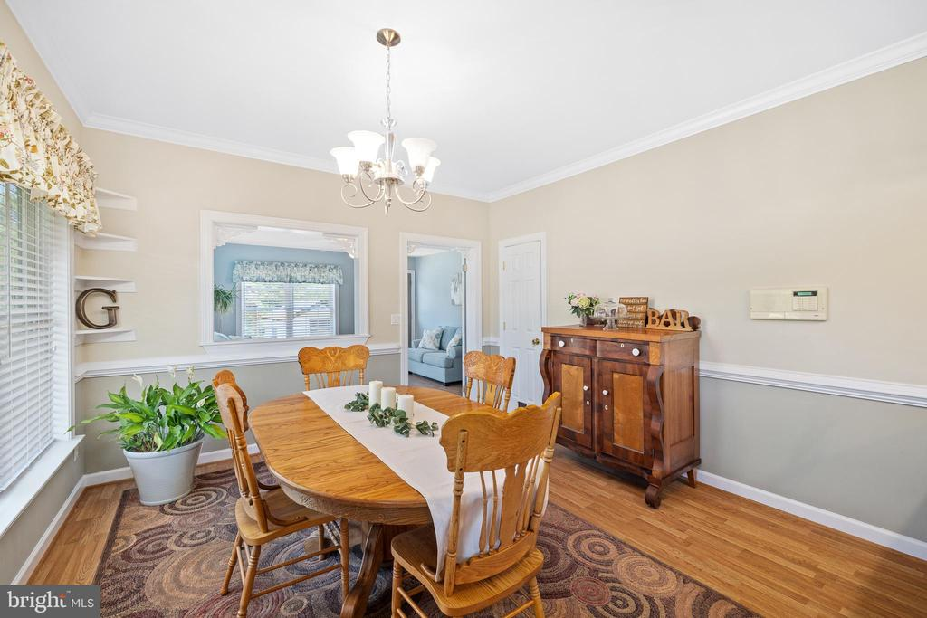 CHAIR & CROWN MOULDING SHOWN IN THE DINING ROOM - 228 ROCK HILL CHURCH RD, STAFFORD