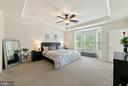 Spacious master bedroom with tray ceiling - 6936 KONA DR, GAINESVILLE