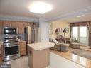 Kitchen flows into Family Room. Pantry by fridge - 4301 CIDER BARREL CT, FREDERICKSBURG