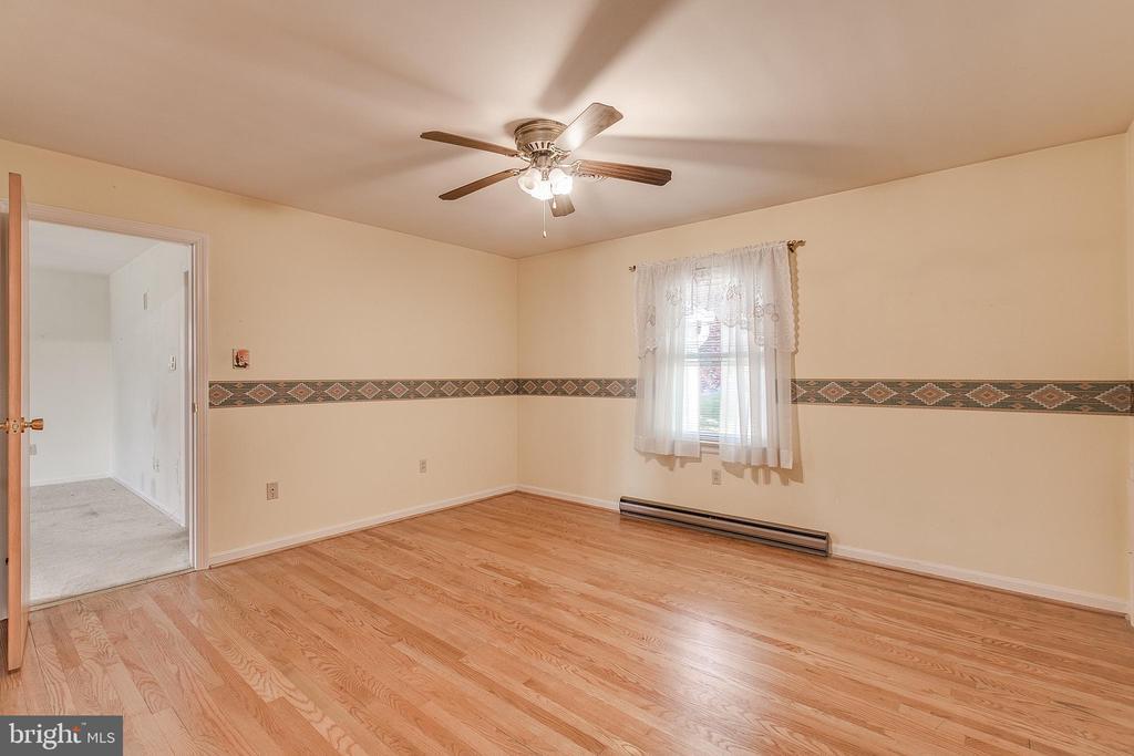 In-law suite bedroom with hardwood floors - 215 BROAD ST, MIDDLETOWN