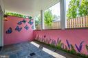 Lower level patio w/access to backyard - 4522 CHELTENHAM DR, BETHESDA