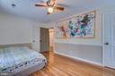Bedroom 2: Wood Flooring, Ceiling Fan, Chair Rail - 3256 TITANIC DR, STAFFORD