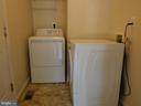 Laundry room at garage door entry - 43114 LLEWELLYN CT, LEESBURG