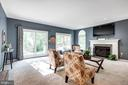Family room with fireplace and doors to the deck - 348 EUSTACE RD, STAFFORD