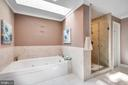 Jetted tub with spa-like atmosphere. - 348 EUSTACE RD, STAFFORD