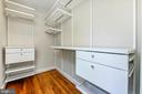 Owner's closet with custom shelving - 4401 GARRISON ST NW, WASHINGTON