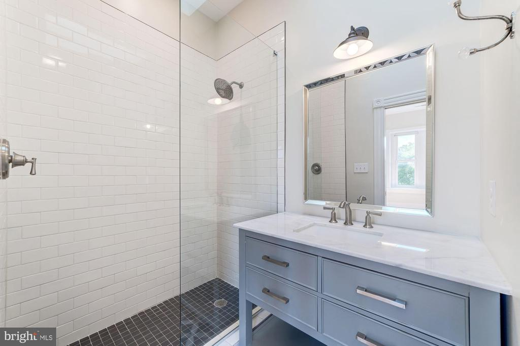 Fully renovated en-suite bath with skylight - 704 G ST NE, WASHINGTON