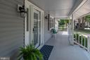 Deep and wide porch laid with mahogany boards - 505 WOODSHIRE LN, HERNDON
