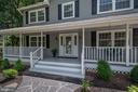 Front porch with wide, curving slate walkway - 505 WOODSHIRE LN, HERNDON