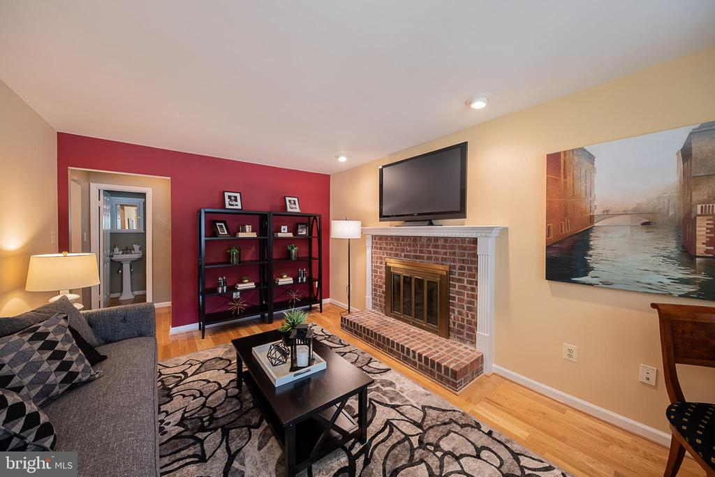 Family room with wood burning fireplace - 505 WOODSHIRE LN, HERNDON