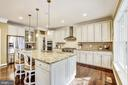 Chefs kitchen with granite counters and island - 3805 COLONIAL AVE, ALEXANDRIA