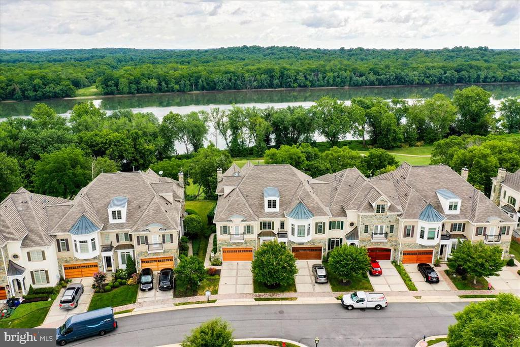 Aerial view  of home; golf course and river beyond - 18356 FAIRWAY OAKS SQ, LEESBURG